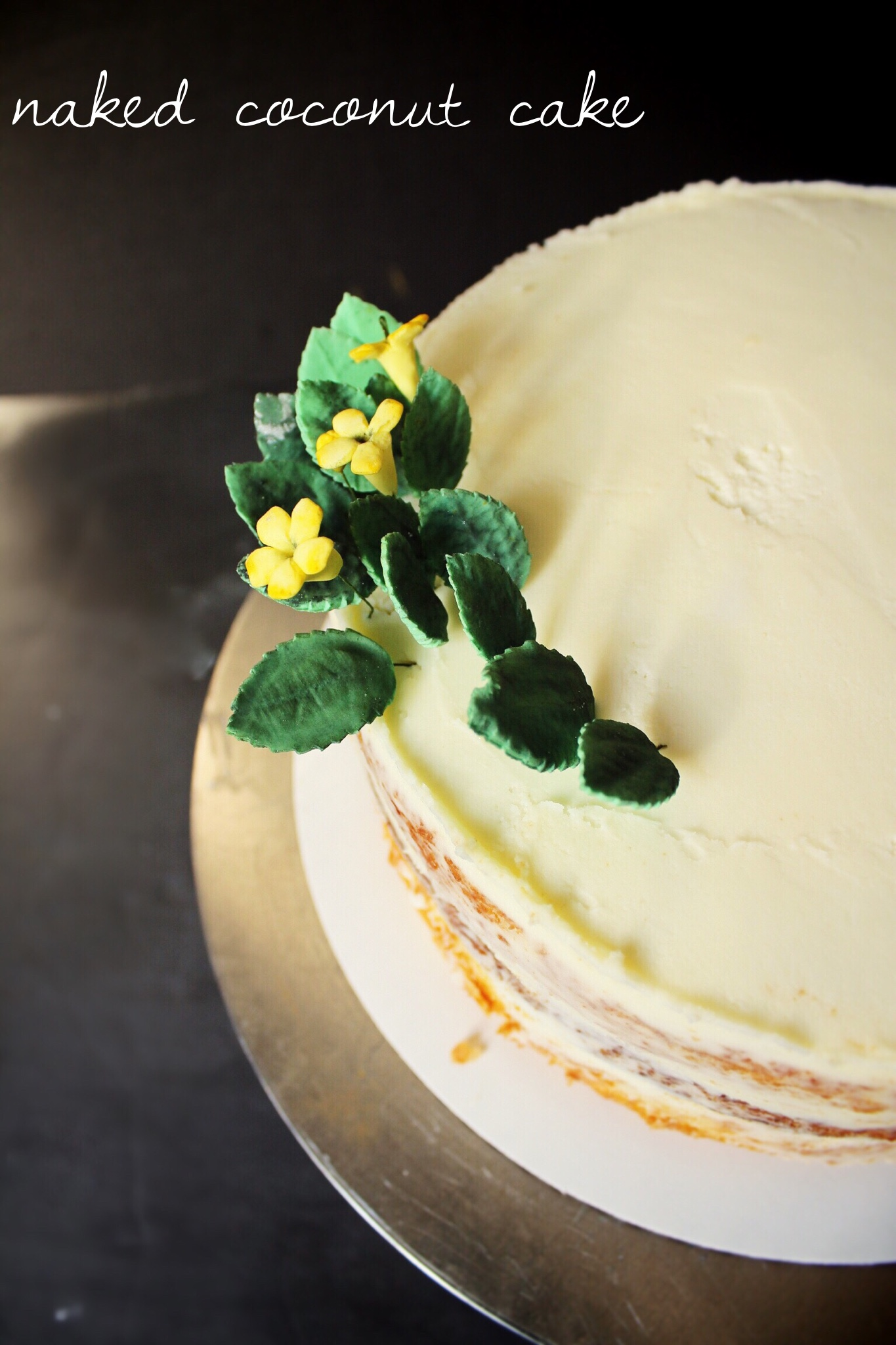 Coconut naked cake with gumpaste leaves and blossoms